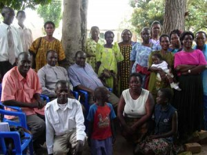 FLP Trainer Ruth (kneeling in white top) with facilitators and clergy at Lowero, Uganda