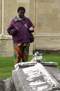 A visiting Mothers' Union worker prays at the Mary Sumner's grave